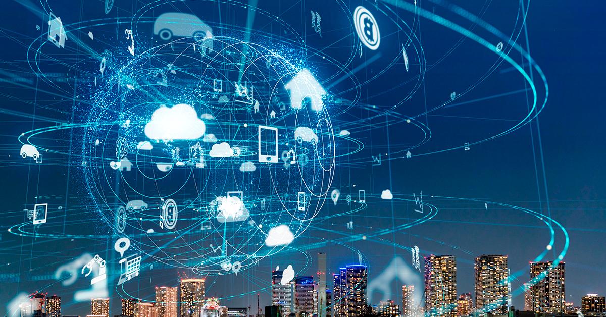 Imagem de uma cidade com elementos referentes à tecnologia, simbolizando o Brain Open Desafio IoT.